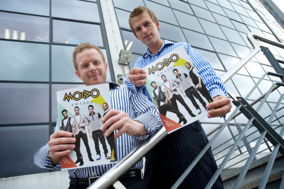 Two of the team with the MOBO Awards Magazine that Impression produced!